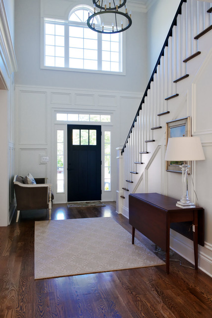 front door with sidelights Entry Traditional with beige rug chandelier clear table lamp console table dark