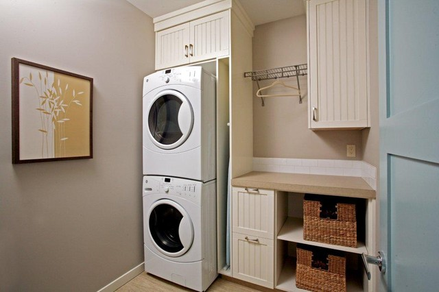 Full Size Stackable Washer and Dryer Laundry Room Traditional with Artwork Beadboard Cabinets Dryer Rack Front Loading Washer And