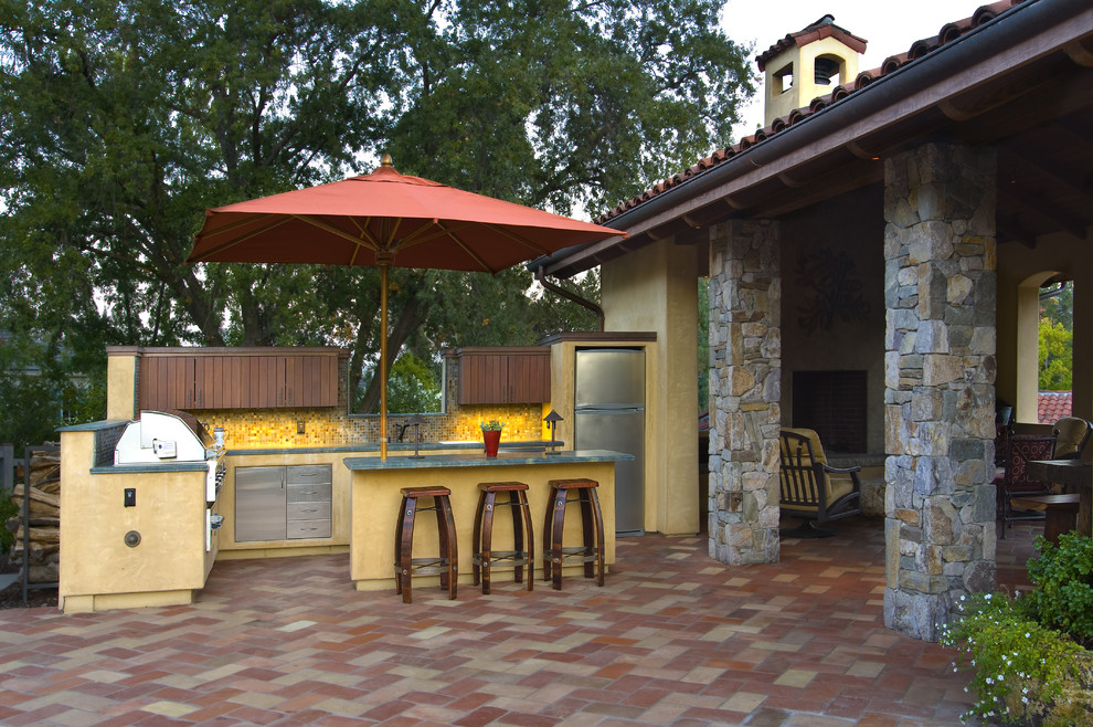 Gladiator Cabinets Patio Mediterranean with Counter Stools Covered Patio Outdoor Kitchen Stainless
