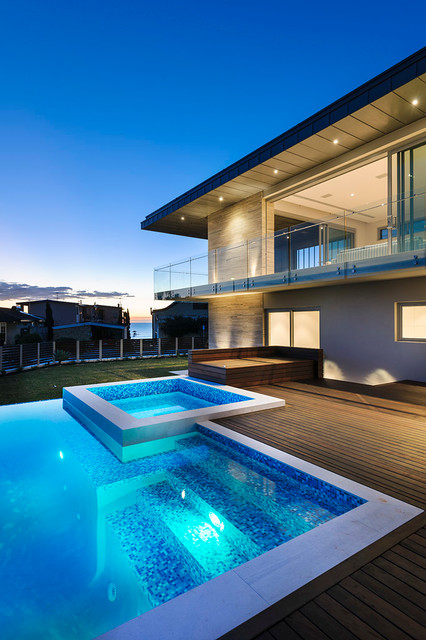 Glass Deck Railing Pool Contemporary with Beach Home Beachfront Beige Stone Exterior Beige Stone Siding1