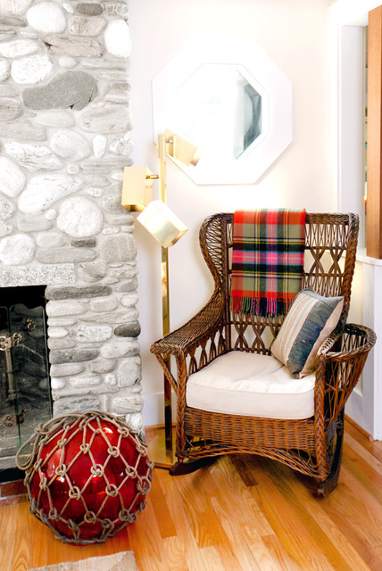 Gliding Rocking Chair Living Room Beach with Glass Fishing Float Reading Nook Red Accent Stone Fireplace