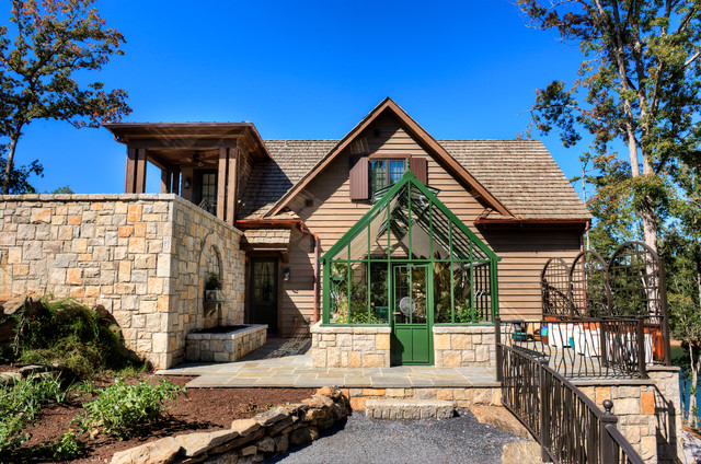 Green House Kits Exterior Traditional with Fountain Gravel Path Greenhouse Patio Shake Roof Stacked Stone