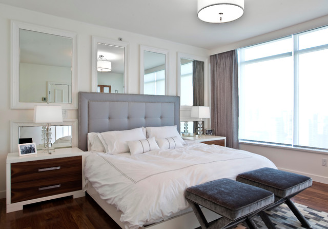 Grey Tufted Headboard Bedroom Contemporary with Ceiling Light Dark Stained Wood Dressers Duvet Stools Gray