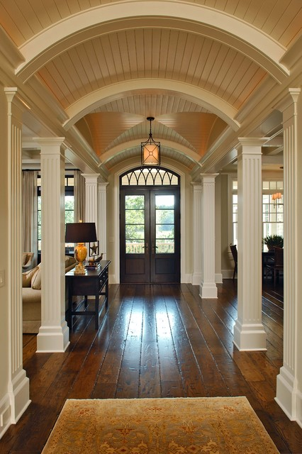 Hand Scraped Wood Floors Entry Traditional with Arched Paneling Columns Dark Console Table Dark Lampshade French