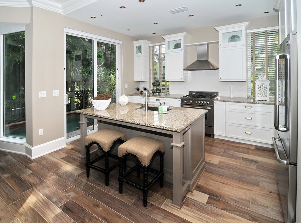 Handscraped Laminate Flooring Kitchen Traditional with Crown and Baseboard Grey Cabinets Marble Countertop
