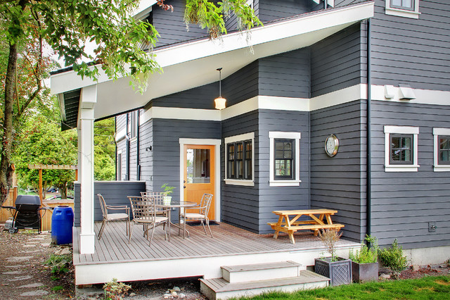 Hardie Board Siding Deck Traditional with Back Door Black Windows Columns Covered Porch Patio Chairs