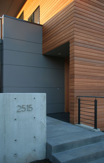 Hardy Siding Entry Modern with Concrete Garden Wall Concrete Steps Covered Entry Cubist Front