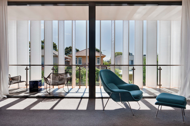 Horizontal Blinds Deck Modern with Balcony Blue Carpeting Chrome Floor to Ceiling Windows Gray Lounge Chair