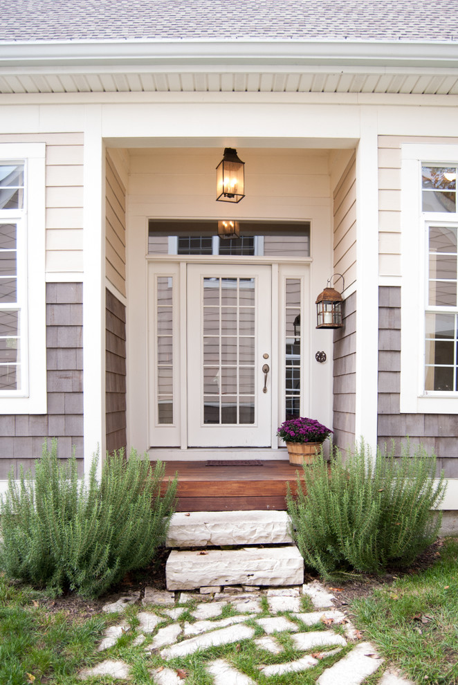 Ipe Decking Entry Farmhouse with Beadboard Ceiling Beige Exterior Beige Siding Bushes
