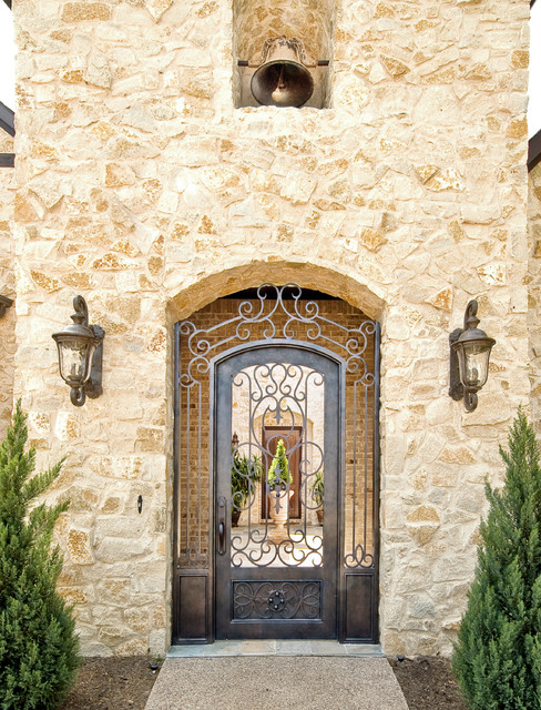 Iron Doors Unlimited Exterior Traditional with Aggregate Concrete Path Arched Doorway Bell Bell Tower Brick