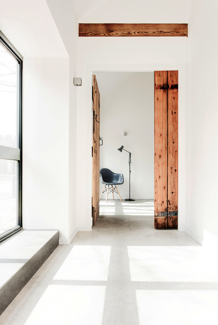 Johns Manville Insulation Hall Scandinavian with Ar Arm Chair Barn Doors Bright Concrete Floor Contemporary
