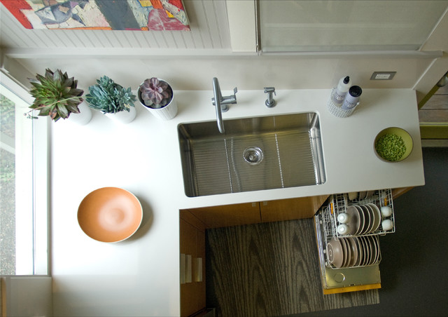 julien sinks Kitchen Contemporary with beadboard wall Caesarstone countertop faucet orange cabinets sink small