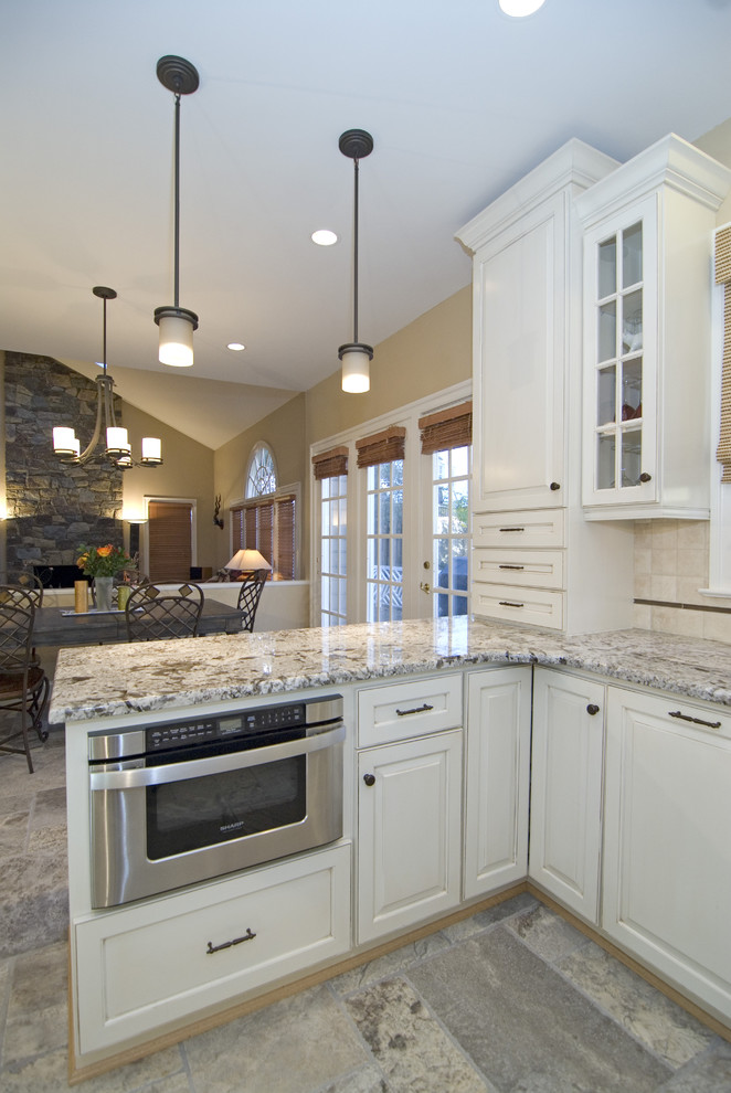 Kichler Lighting Kitchen Traditional with Ceiling Lighting Glass Front Cabinets Granite Countertops