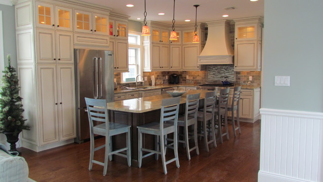 Kraftmaid Cabinetry Kitchen Traditional with Cabinet Style Exhaust Hood Cherry Cabinetry in Saddle Suede