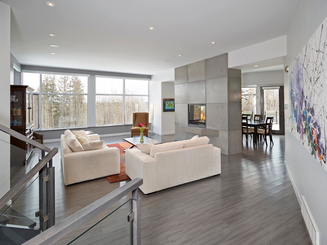 Lauzon Flooring Living Room Contemporary with Beige Armchair Beige Sofa Concrete Fireplace Double Sided Fireplace Gray
