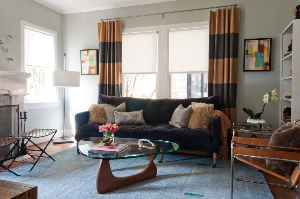 leather sling chair Living Room Contemporary with area rug artwork bookshelves curtain panels Fireplace