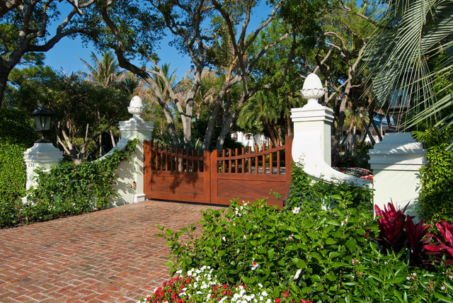 Liftmaster Gate Opener Landscape Tropical with Brick Driveway Gate Outdoor Lantern Palm Tree Red Flowers