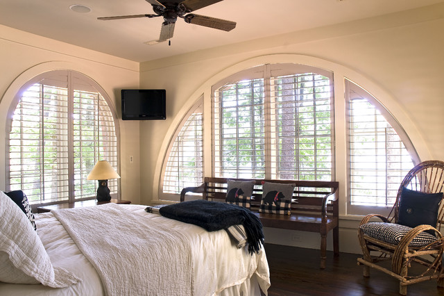 louvered shutters Bedroom Traditional with ceiling fan dark floor decorative pillows navy blue throw