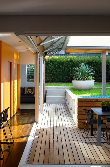 Louvered Windows Porch Modern with Counter Stools Deck Lawn Louvered Windows Orange Walls Outdoor1