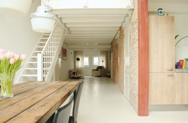 Lowes Laminate Flooring Living Room Industrial with Exposed Brick Flat Panel Cabinets Loft Open Tread Staircase