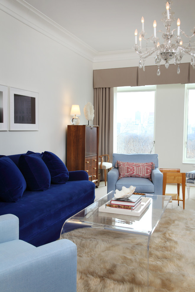 Lucite Coffee Table Family Room Eclectic with Area Rug Artwork Blue Sofa Crystal Chandelier