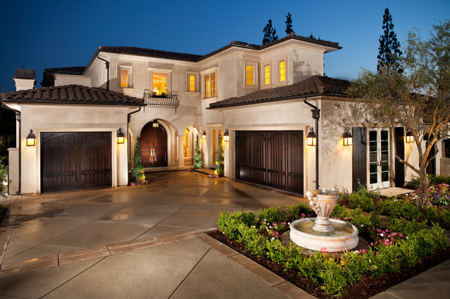 Mediterranea Tile Exterior Mediterranean with Arched Doorway Clay Tile Roof Colums Concrete Drveway Fountain1