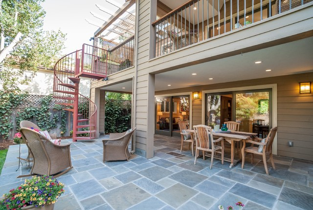 Metal Spiral Staircase Patio Traditional with Beige Exterior Beige Siding Lattice Fence Metal Railing Metal