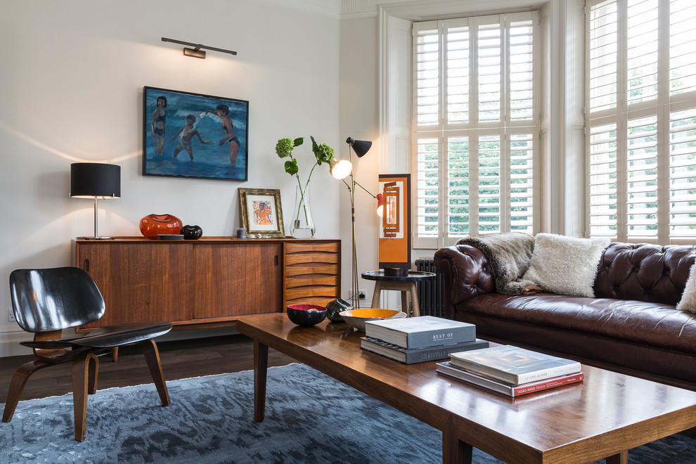 Mid Century Credenza Living Room Midcentury with Artwork Blue Ikat Area Rug Brown Couch