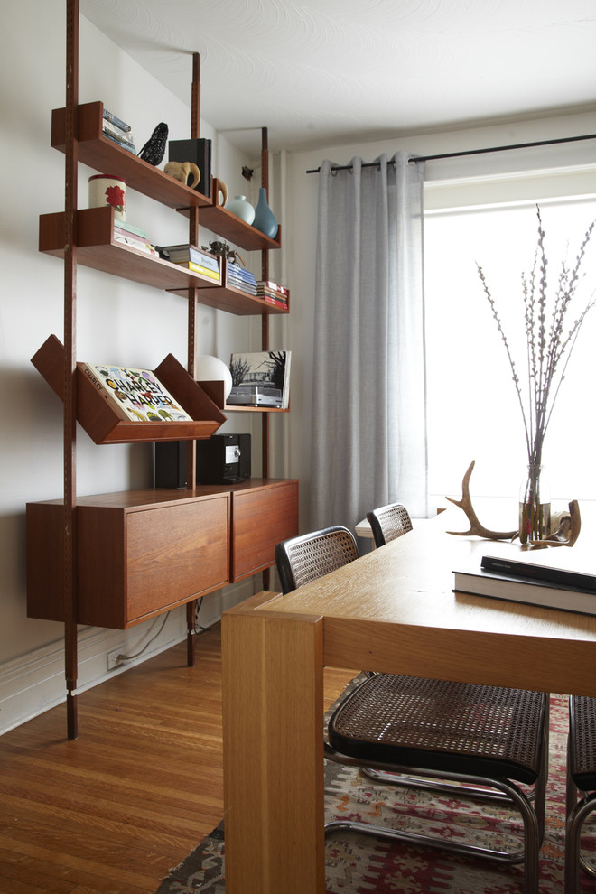 Mid Century Modern Bookcase Dining Room Scandinavian with Baseboards Cane Dining Chair Charley Harper Curtains1