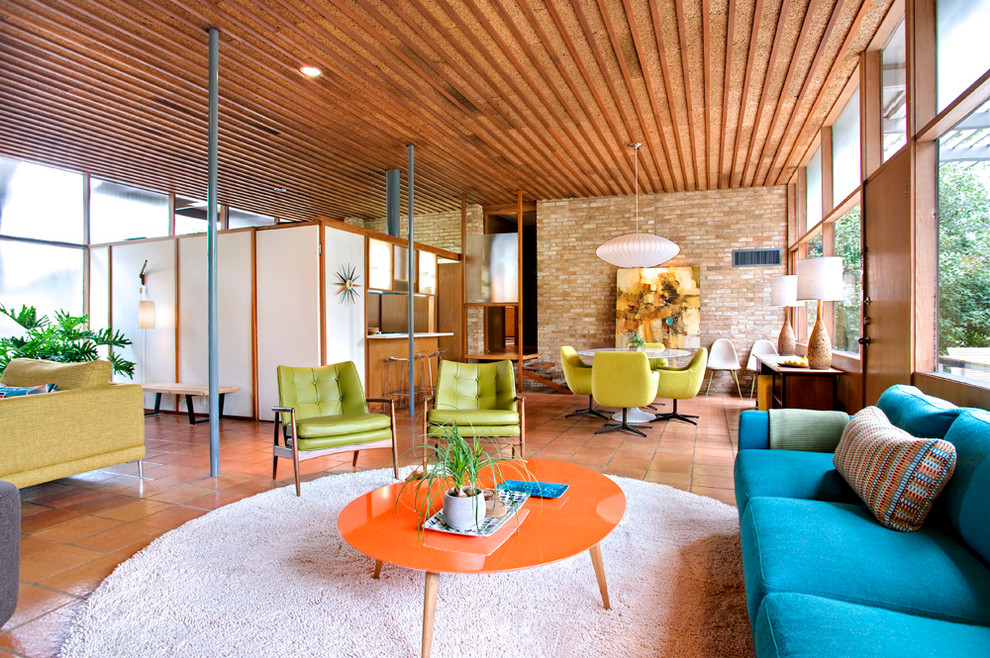 Mid Century Modern Furniture Reproductions Family Room Midcentury with Beige Rug Brick Wall Bright Blue Sofa