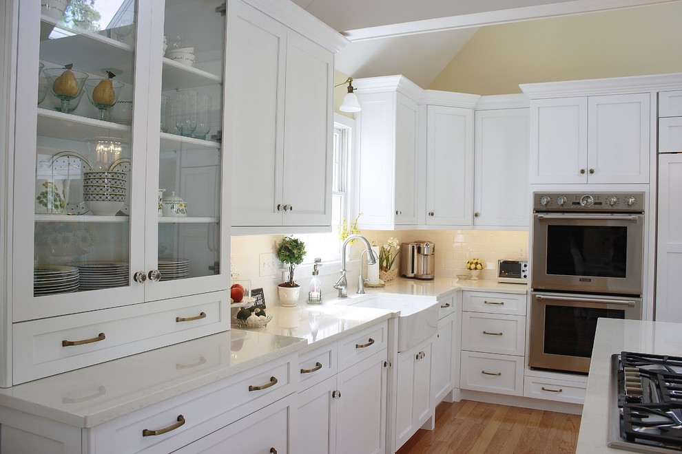 Moen Brantford Kitchen Transitional with 3x6 Subway Tile Bright Bronze Hardware Cabinetry