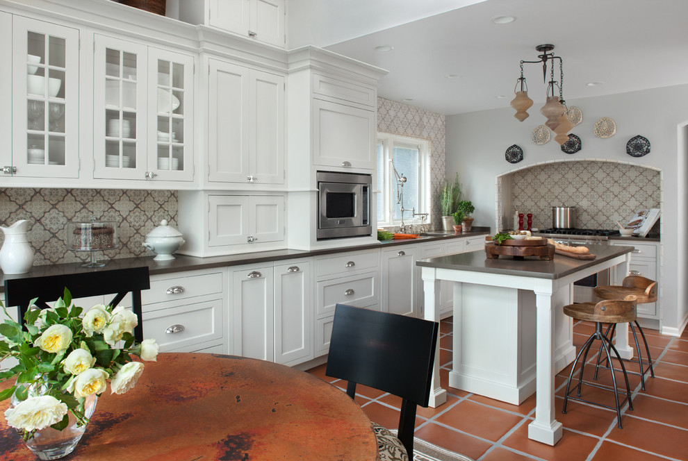 moroccan tile backsplash Kitchen Traditional with arch archway beige patterned tiles black dining