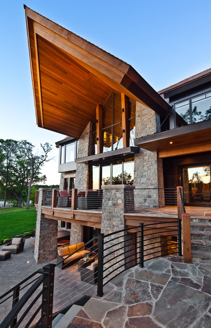 Mueller Roofing Exterior Eclectic with Balcony Cable Railing Cantilevered Custom Deck Denali Flagstone Lake