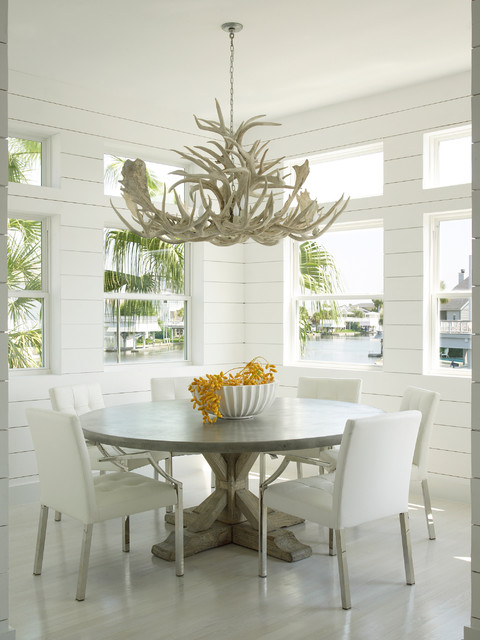 Mullican Flooring Dining Room Beach with Antler Chandelier Round Dining Table Transom Windows White Chairs