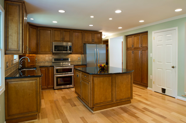 Mullican Flooring Kitchen Traditional with Black Countertop Black Galaxy Granite Brown Cabinets Built in Pantry
