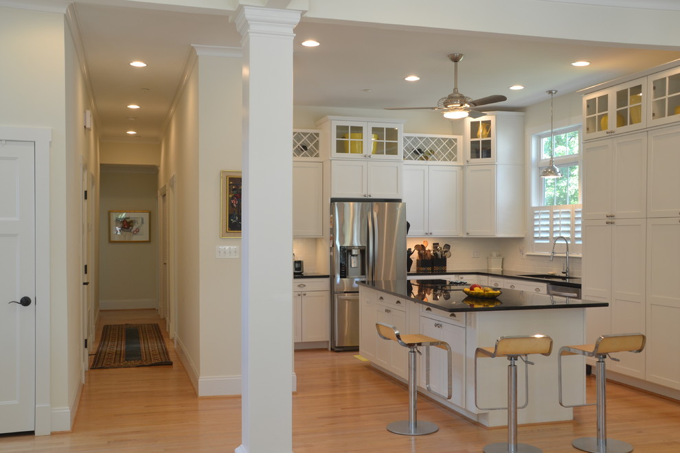 nautical ceiling fans Kitchen Contemporary with barstools black marble countertops ceiling fan column