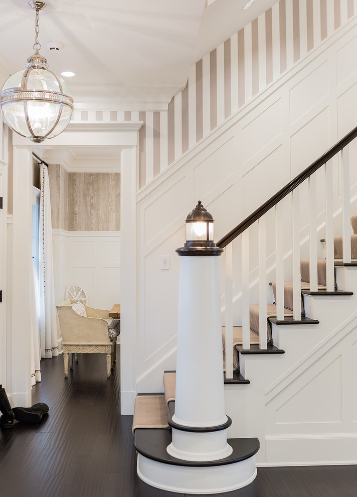 newel post staircase traditional with curtail five panel door greek