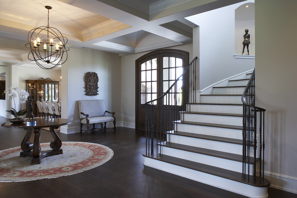 Nicole Miller Home Decor Entry Traditional with Arched Doorway Chandelier Coffered Ceiling Dark Stained1