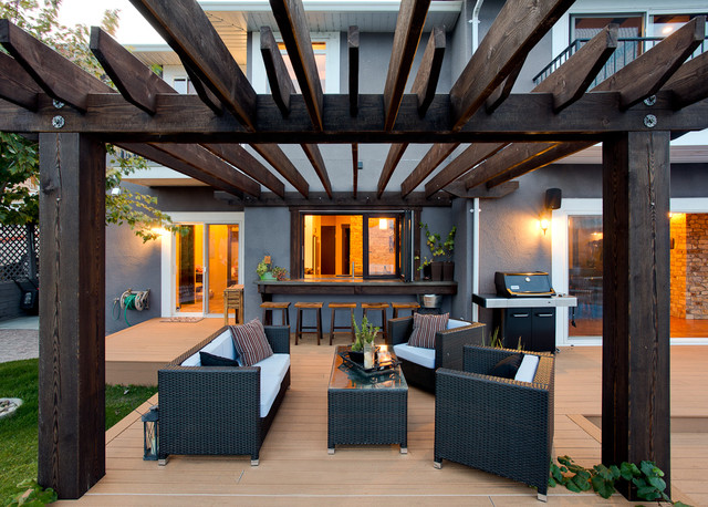 Norelco Patio Traditional with Elevated Wood Platform Grass Gray Stucco Exterior Gray Stucco