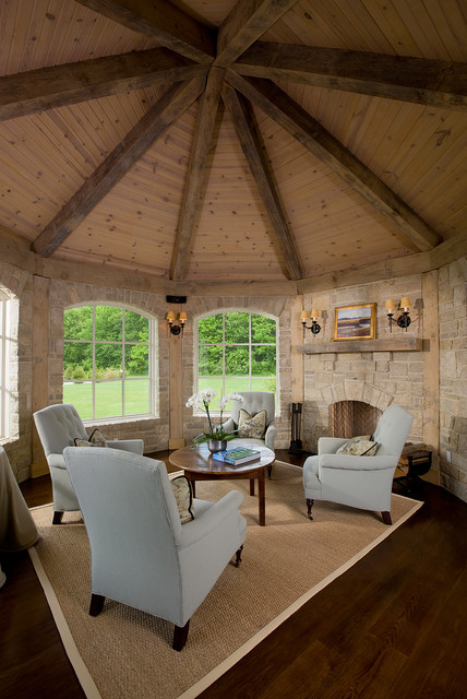 Octagon Rugs Family Room Traditional with Arched Window Beige Rug Dark Wood Floor Gray Armchair