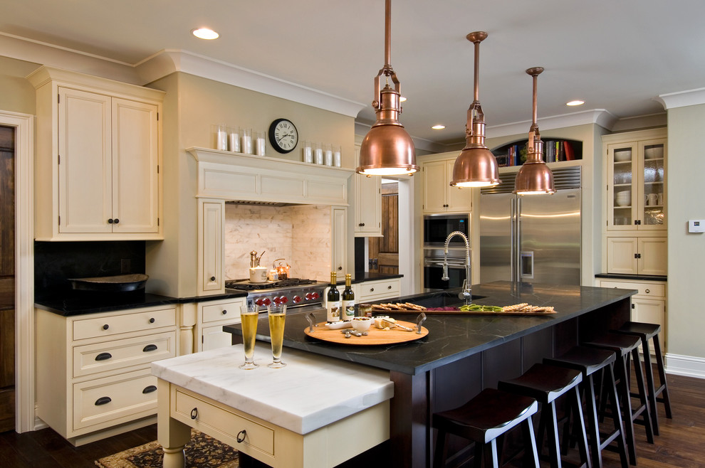 Oil Rubbed Bronze Cabinet Hardware Kitchen Traditional with Copper Pendant Lights Counter Stools Crown Molding