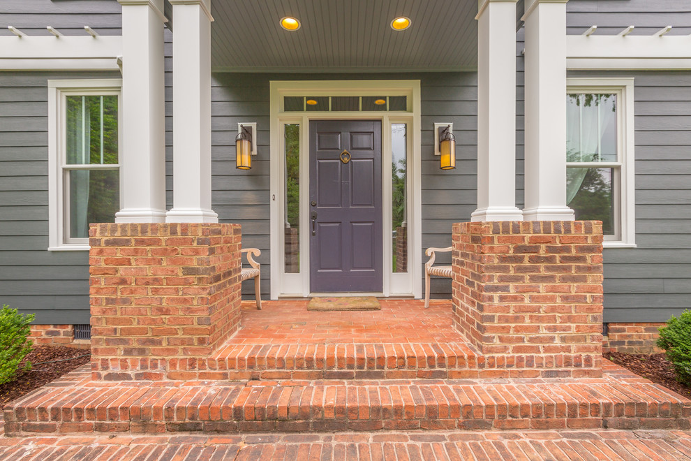 Outswing Exterior Door Entry Traditional with Autumn Bench Seating Blue Door Brick Entry