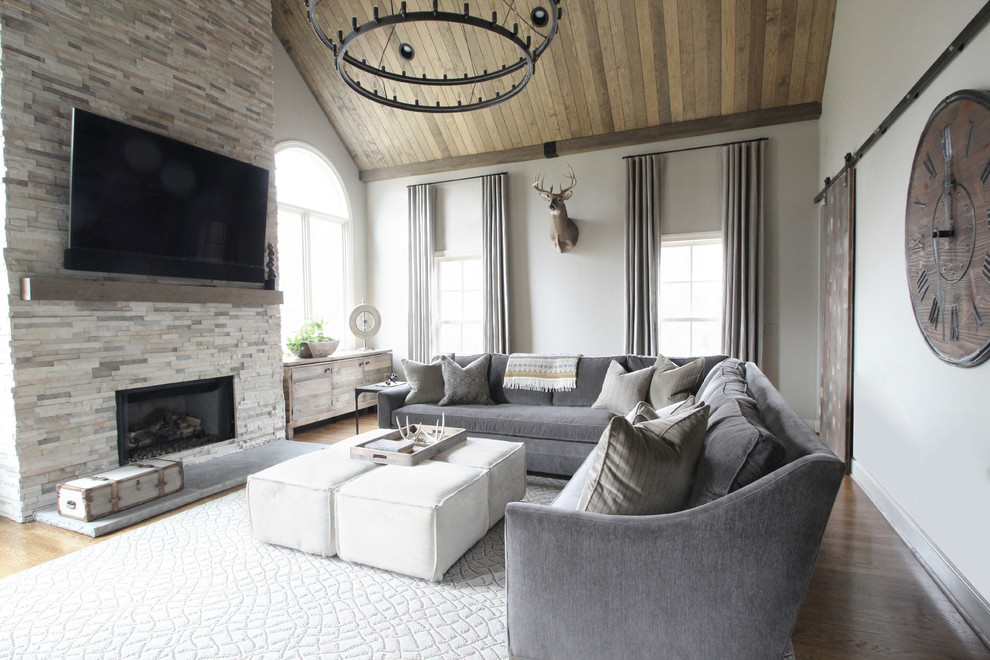Oversized Sectionals Family Room Transitional With Arched Windows Barn Door  Chandelier Deer Head