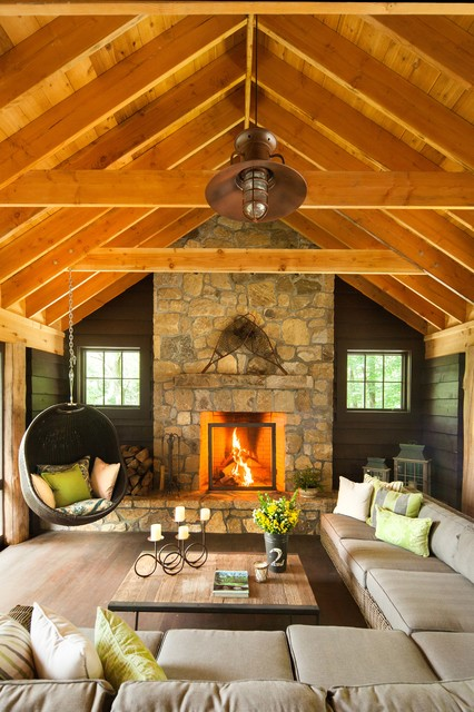 Papasan Chairs Living Room Rustic with Cathedral Ceiling Ceiling Rafters Fire Screen Fire Wood Green