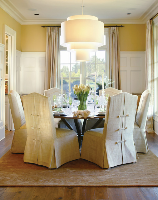 parson chairs Dining Room Traditional with area rug CEILING LIGHT crown molding curtain panels frame