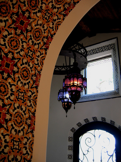 Passages Malibu Entry Mediterranean with Decorative Tiles Decorative Tiles in Arch Iron Glass Front