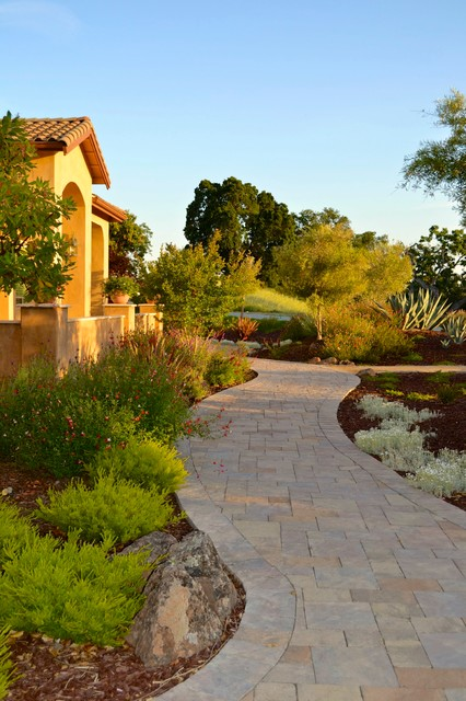 pavestone pavers Landscape Mediterranean with bushes California Native Plants curved pathway curved walkway deer