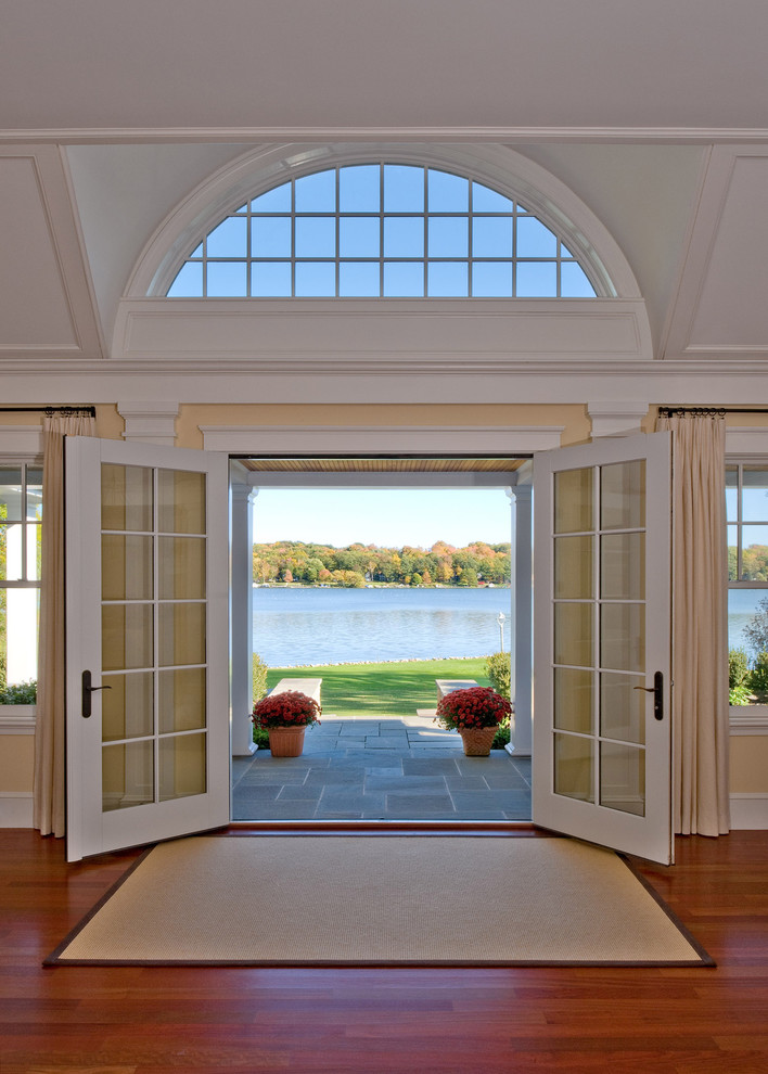 Pella Storm Doors Entry Traditional with Arched Window Area Rug Back Porch Bluestone
