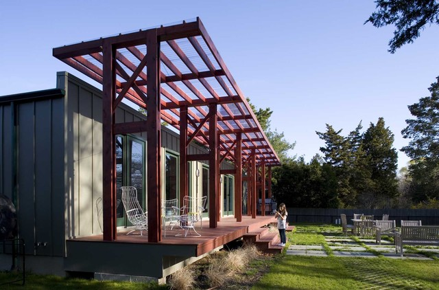 Polycarbonate Greenhouse Porch Industrial with Awning Clear Roof Awning Concrete Pavers Deck Grass Green