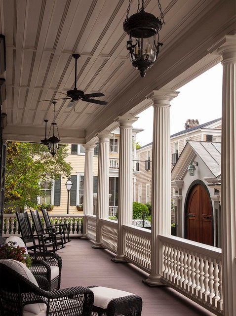 porch pillars Porch Victorian with black wicker furniture ceiling fan fluted columns pendant light